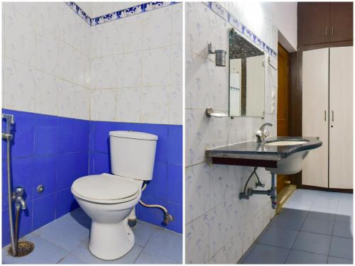 A bathroom at Capital O 76515 Hotel Bharat Lake View Resort