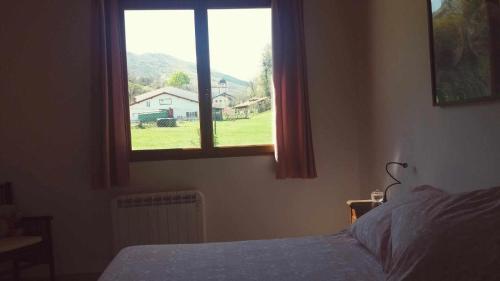 Un ou plusieurs lits dans un hébergement de l'établissement Habitacion dormitorio rural itaka
