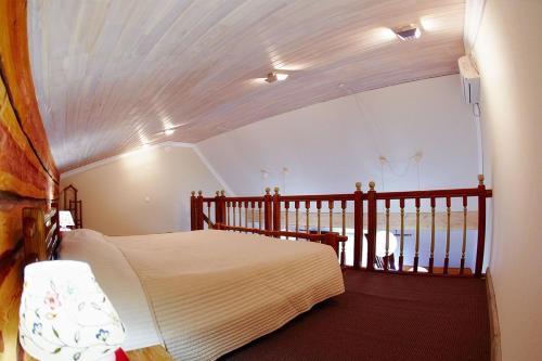 Кровать или кровати в номере Золотой Пляж