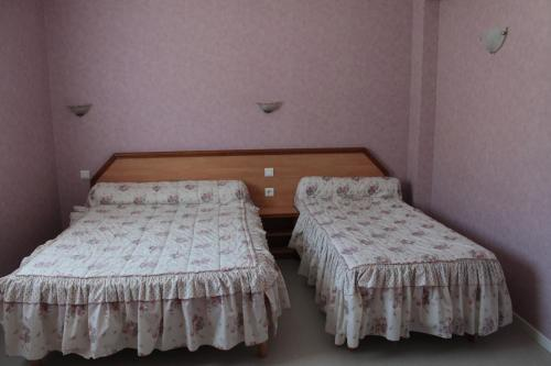 A bed or beds in a room at Hôtel Ladagnous