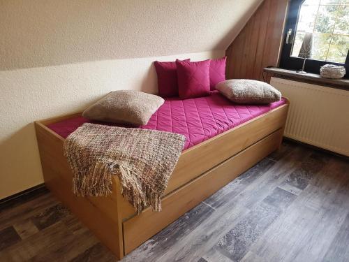 A bed or beds in a room at Ihr Urlaub ist unsere Herzenssache