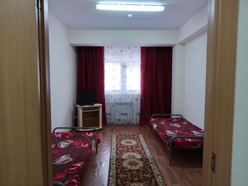 A bed or beds in a room at Studio in Estosadok