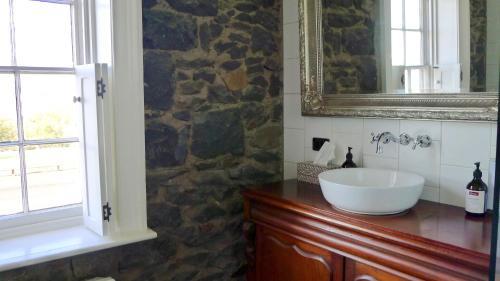 A bathroom at Elephant Bridge Hotel