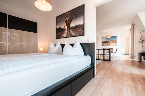 Ein Bett oder Betten in einem Zimmer der Unterkunft Hotel Alt-Weimar