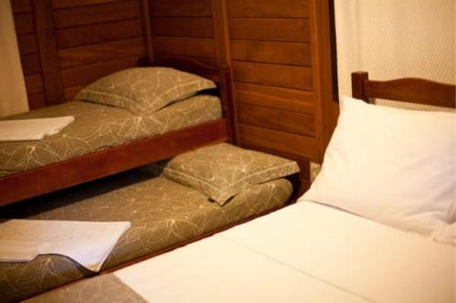 A bed or beds in a room at Caraguata Pousada