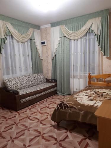 A bed or beds in a room at На Партизанской 29б