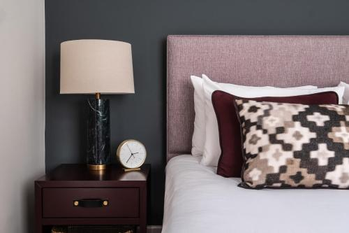 A bed or beds in a room at Native Mayfair
