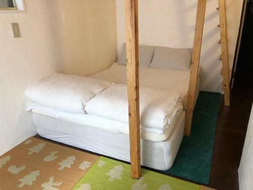 Hostel ユメノマドにあるベッド