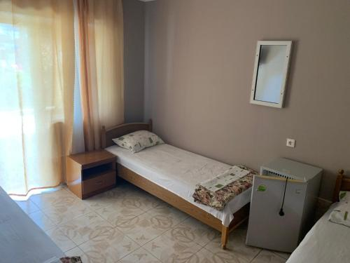 "A bed or beds in a room at Гостевой Дом ""ДИАНА"""