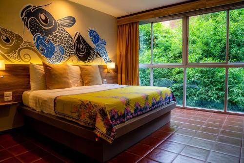 Cama o camas de una habitación en Sino House Phuket Hotel