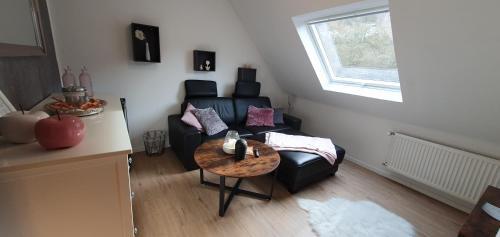 Ein Sitzbereich in der Unterkunft Gästehaus Burgberg, Weinhaus Fries