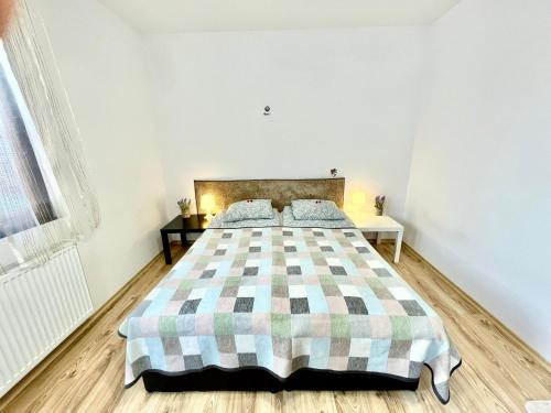 A bed or beds in a room at Kassandrova House
