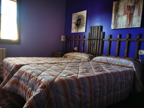 A bed or beds in a room at Cornatel Médulas