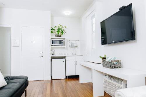 A kitchen or kitchenette at Riviere South Beach Hotel