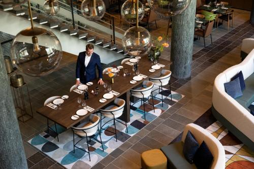A restaurant or other place to eat at The Slaak Rotterdam, a Tribute Portfolio Hotel