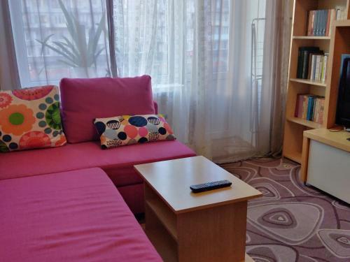Гостиная зона в Apartments at Aprelskaya 5