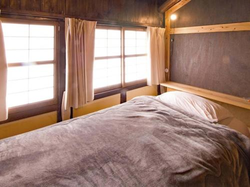 A bed or beds in a room at Hostel & Tatami Bar Uchikobare