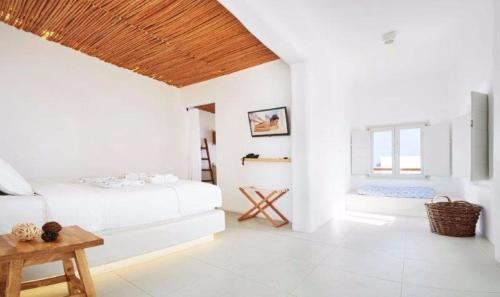A bed or beds in a room at Rocabella Santorini Hotel & Spa