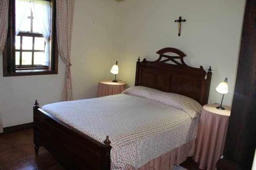 Uma cama ou camas num quarto em Quinta do Pomarinho