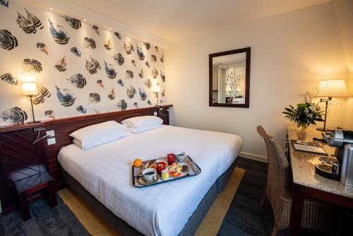 Un ou plusieurs lits dans un hébergement de l'établissement Hôtel La Villefromoy