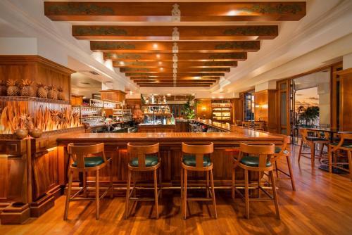 The lounge or bar area at Grand Hyatt Kauai Resort & Spa