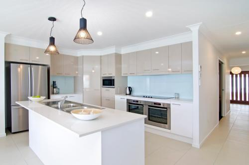 A kitchen or kitchenette at Sentosa on Tugun - Beachfront 5 Bedroom