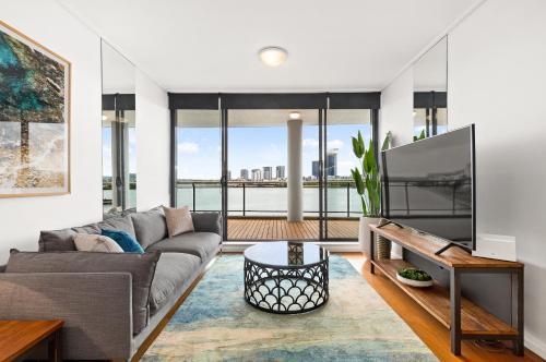 A seating area at Homebush Bay Self-Contained Modern Two-Bedroom Apartments (BEN)