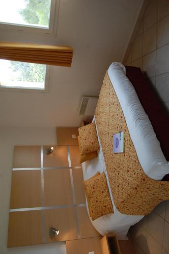 Un ou plusieurs lits dans un hébergement de l'établissement Résidence Côté Sud Peypin