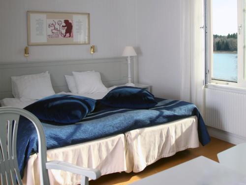 Säng eller sängar i ett rum på Södertuna Slott