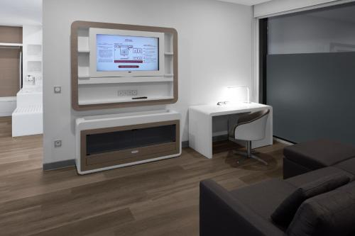 A television and/or entertainment center at YOTELAIR Istanbul Airport, Duty free - International Transit area