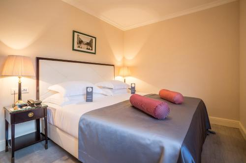 A bed or beds in a room at Hotel Park Split