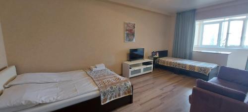 Кровать или кровати в номере Апартаменты на Навагинской 16