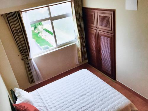 A bed or beds in a room at OSC 3pn 4bed, view TP - Giá hấp dẫn, có hồ bơi