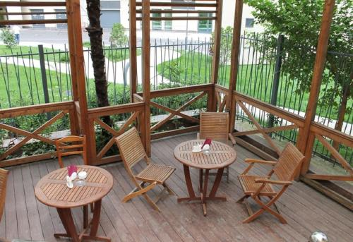 A balcony or terrace at Sunlion Баунти Hotel