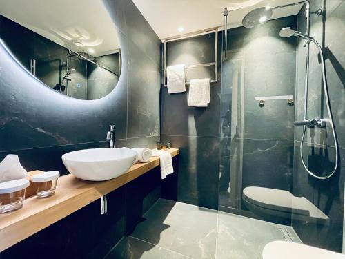Een badkamer bij Hotel de Sterrenberg - Adults Only