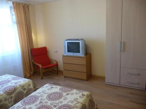 A television and/or entertainment center at Apartments Krasnogorsk Expo