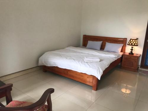 A bed or beds in a room at VuLinh Family Homestay