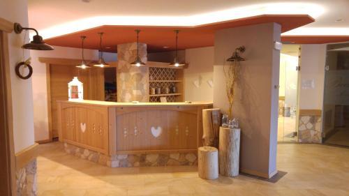 Hall o reception di Alpen Garten Hotel Margherita