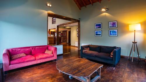 Coin salon dans l'établissement Hotel Poincenot