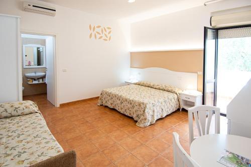 Letto o letti in una camera di Giardino Degli Ulivi Resort and SPA
