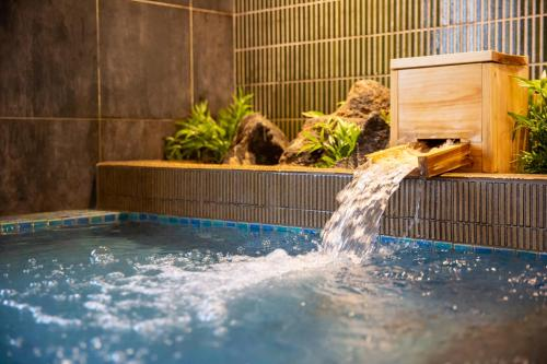The swimming pool at or near Cabin & Capsule Hotel J-SHIP Osaka Namba