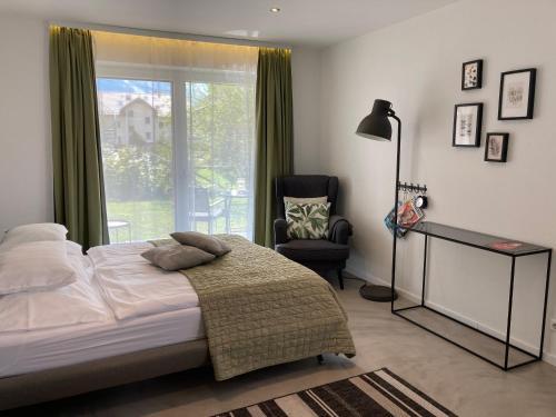 Ein Bett oder Betten in einem Zimmer der Unterkunft Kal's Studio Apartment Salzburg