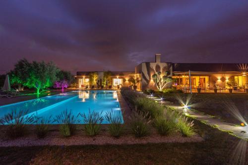 The swimming pool at or near Villa Jardins D'Isa