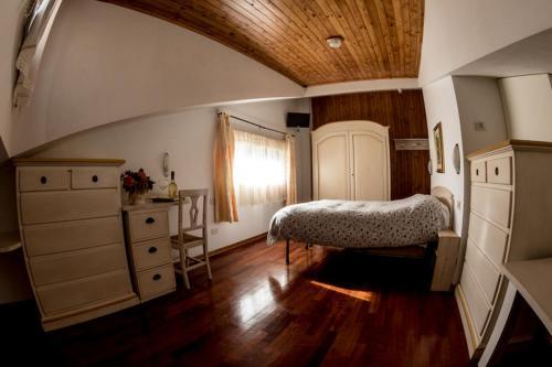 Letto o letti in una camera di Albergo Generale Cantore - Monte Amiata