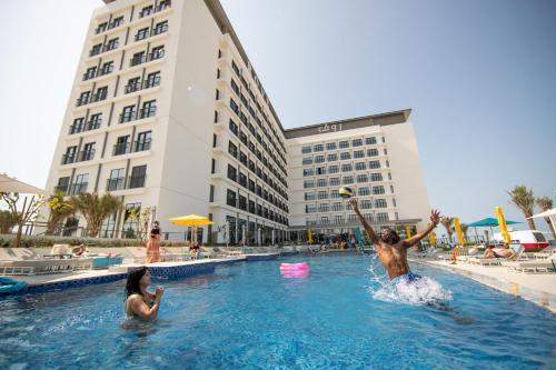 The swimming pool at or near Rove La Mer Beach