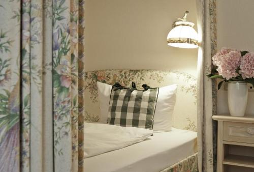 Ein Bett oder Betten in einem Zimmer der Unterkunft Villa Adolphine