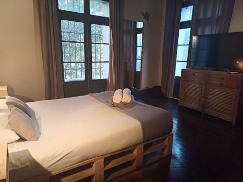 Cama ou camas em um quarto em Hostel Boutique Merced 88