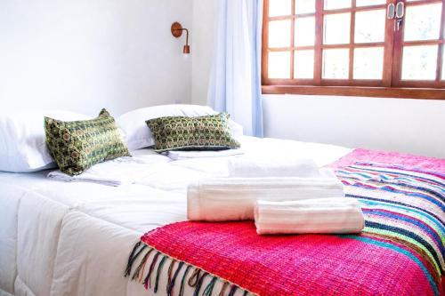 Cama ou camas em um quarto em Pousada Saruê Natal