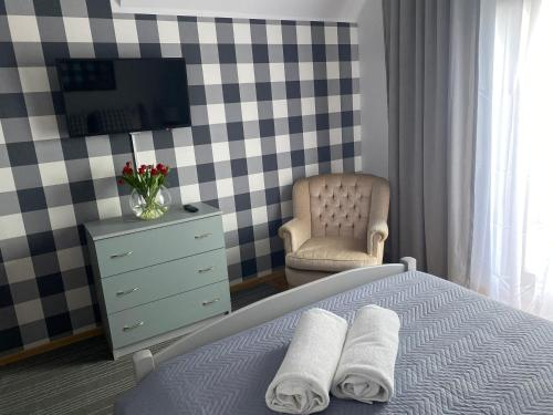 Кровать или кровати в номере Gościniec Pod Lipą