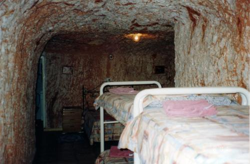 A bunk bed or bunk beds in a room at Radeka Downunder Underground Motel